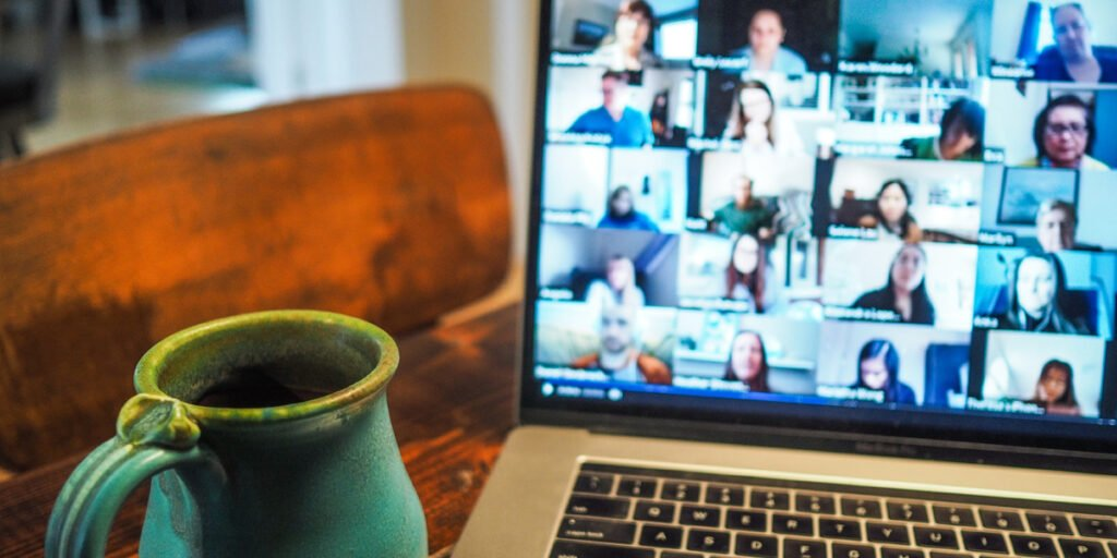 Photo by Chris Montgomery on Unsplash Go to Chris Montgomery's profile Chris Montgomery @cwmonty macbook pro displaying group of people Zoom call with coffee